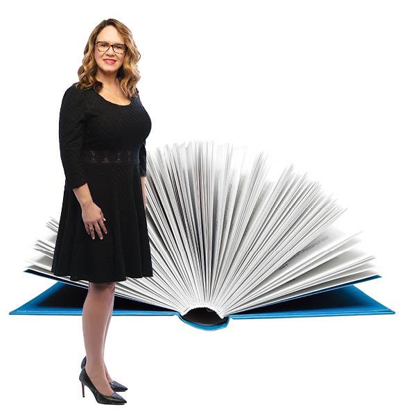 Amanda standing in front of open book